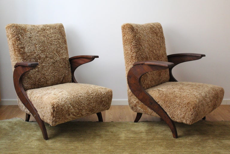 A pair of organic lounge chairs / arm chairs. Designed and produced in Italy, 1940s-1950s.   Restored and reupholstered in brand new sheepskin upholstery.  Other designers of the period include Carlo Mollino, Franco Campo & Carlo Graffi, Isamu