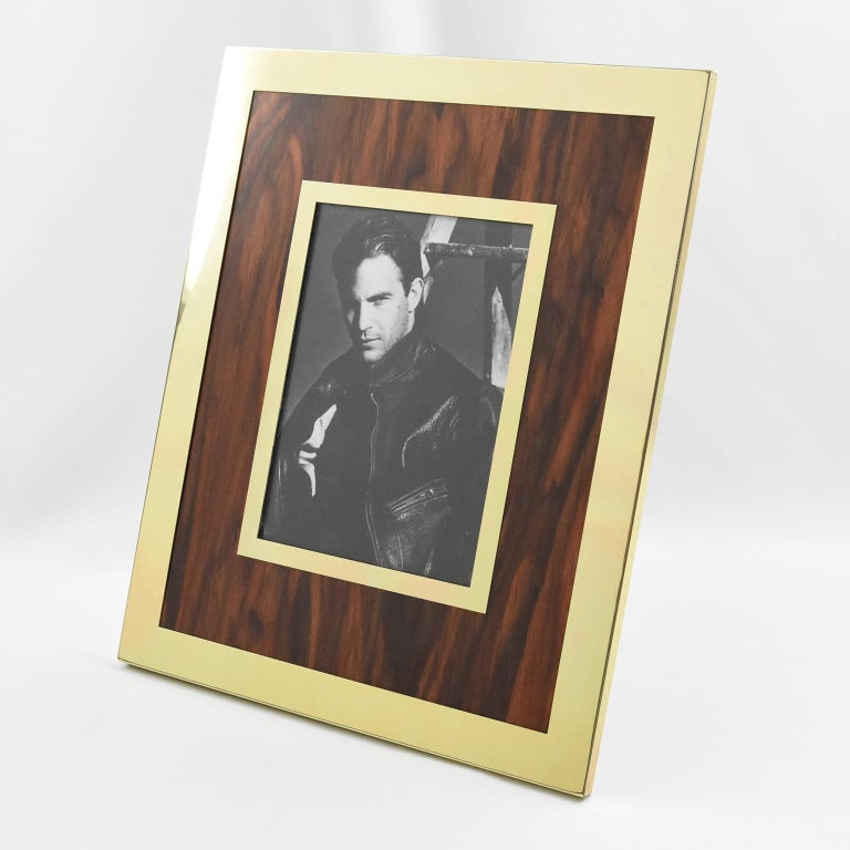 Lovely 1970s picture photo frame, manufactured by Italian company MB. Gilded aluminium and formica imitating flamed walnut wood. Metal easel at the back. Marked on easel: 'Made in Italy - MB brand logo'. Measurements: Overall: 10.44 in. wide (26.5