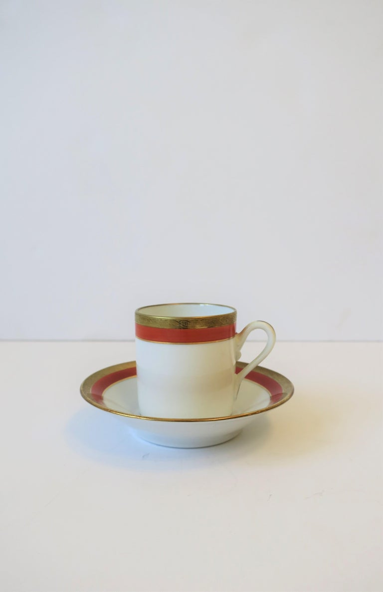 A beautiful Italian white and orange porcelain and gold gilt decoration espresso coffee or tea demitasse cup and saucer by designer Richard Ginori, circa mid-20th century, Italy. Colors include: White, orange and gold gilt. With maker's mark on