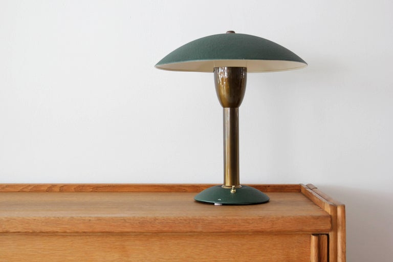 Handsome Italian desk light in brass and green aluminum.