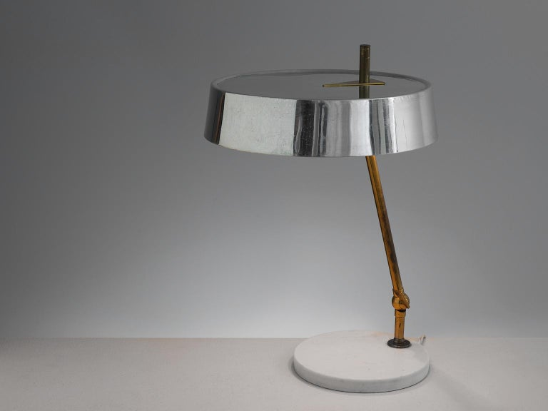 Desk lamp, marble, metal, brass, Italy, 1950s.  Stylish desk light with mirrored shade. The circular shade matches the brass stem and the base perfectly. The base is a white marble circle on which the brass stem stands. The stem can be adjusted in