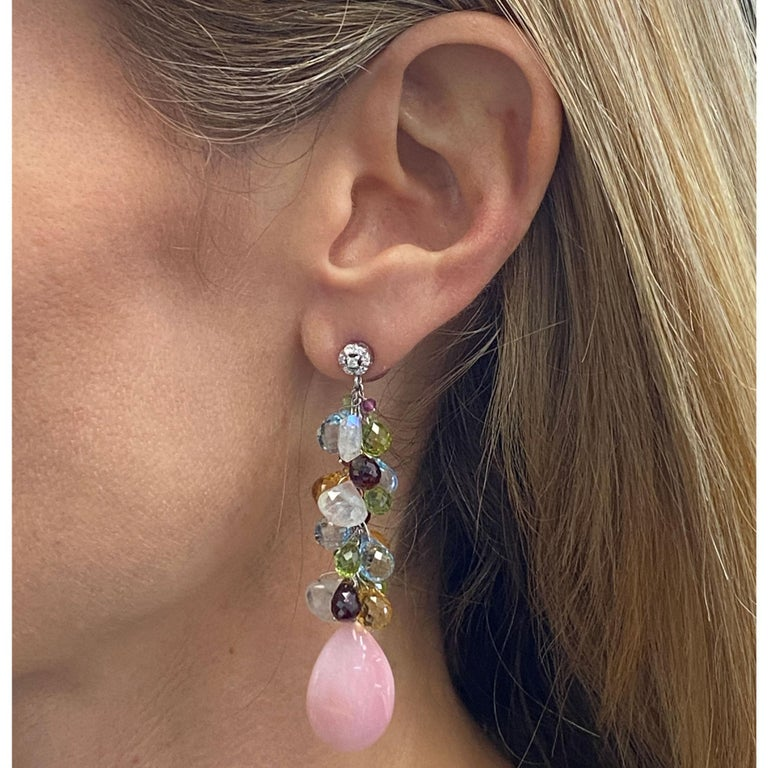 Colorful diamond and gemstone earrings by Italian designer Zoccai. The drop earrings feature round brilliant cut diamonds, colorful briolette cut gemstones, and coral drops. The earrings are fashioned in 18 karat white gold and measure 2.5 inches in