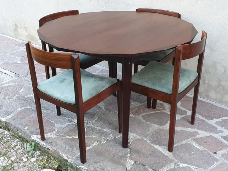 The Italian dining room table is designed by Dino Cavalli and accompanied by four chairs made for Tredici Srl Pavia. Chairs are reupholstered in green color velvet. Table is extendable for  six people and extends to 65 inches. Currently located in