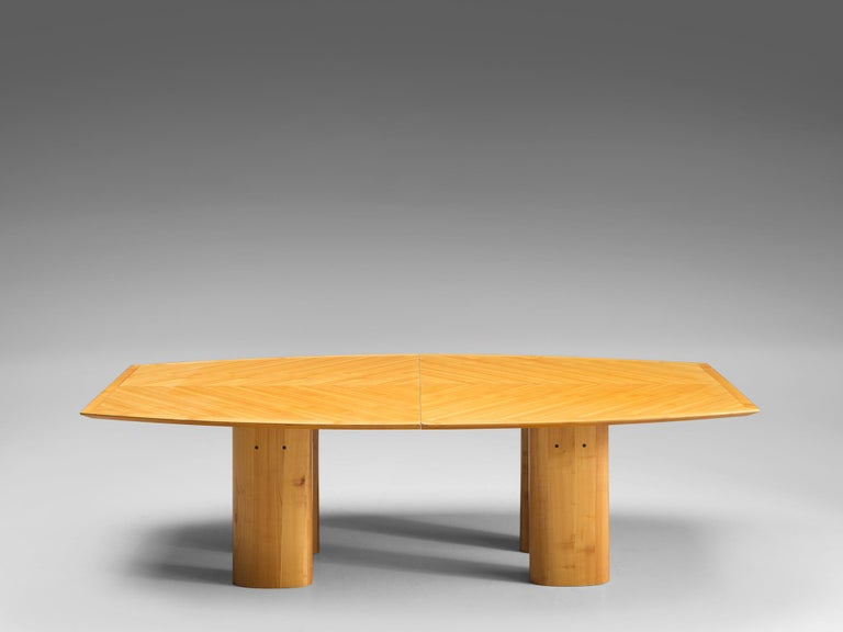 Italian dining table, beech, Italy, 1970s  This sculptural table not only features four oval legs but also a boat shaped top. The top is highlighted with beautiful beech grains and actually constists out of two similar parts. The bright and warm