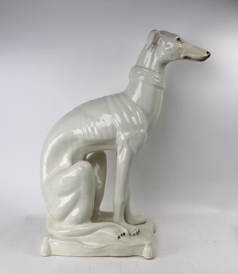 Decorative Italian ceramic faience seated dog figure. Done in off white, free of damage, chips, cracks or repairs. Charming, chic and sophisticated, clean and ready to use condition.