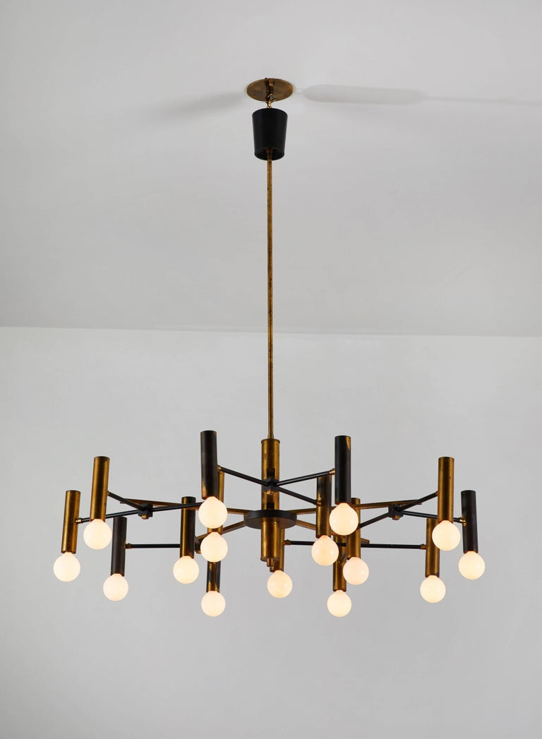 Fifteen-Arm Chandelier manufactured in Italy by Oscar Torlasco circa 1950's. Brass and enameled metal. Original canopy with custom ceiling plate. Wired for US junction boxes. Takes 15 25w maximum European candelabra bulbs