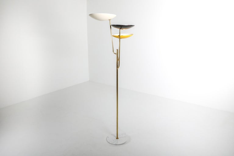 Arredoluce style uplighting floor lamp, Italy 1950s  Tricolor floor lamp, brass stem and white, yellow and black lacquered metal shade.