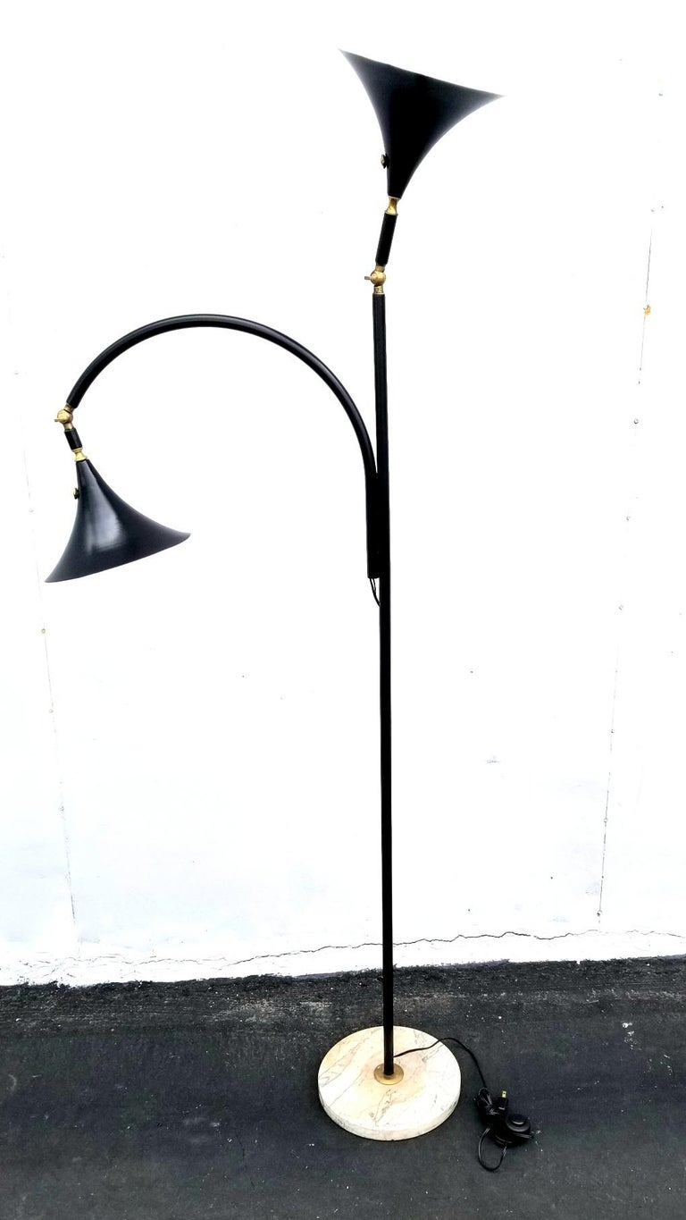 Italian floor lamp with two pivoting shades and marble base. Brass neck allow to change the position of the shades.
