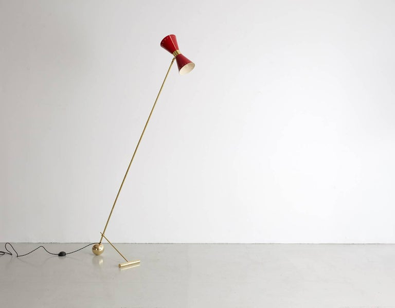 Italian floor light in the style of Stilnovo with articulating red shade, brass stem and counter weight ball foot. Newly produced in Italy and newly rewired.
