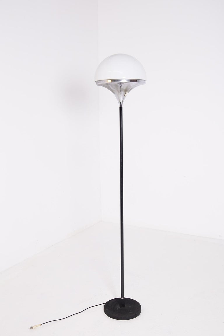 Floor lamp manufactured by Stilnovo at the end of the 50s and beginning of the 60s.  The terr lamp is made with an iron or cast iron base painted black with a painted steel stem. The ceiling lamp that contains its light and semi-spherical opaline