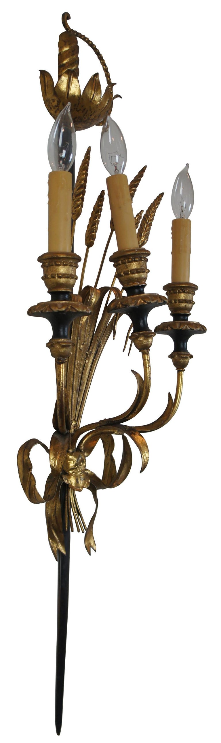 """Vintage Italian toleware Florentine three-light wall sconce shaped like a small sheaf of wheat tied with a bow to a rapier or sword. Measures: 37""""."""