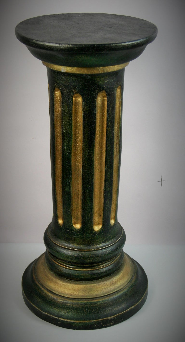 8-140 an Italian fluted wood pillar column pedestal side or drink table. Hand painted in green or black with gilt detailing. Pedestal is in the style of a Doric order column Measures: Top diameter 10.5
