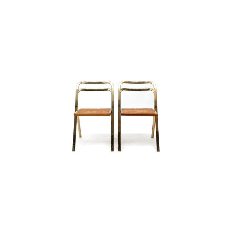 Set of 2 folding chairs by Giorgio Catellan for Cidue, Italy, 1970. These chairs are a beautiful shaped design pattern model, very elegant and functional. They fit together in each other very efficiently. They have been manufactured by Cidue,