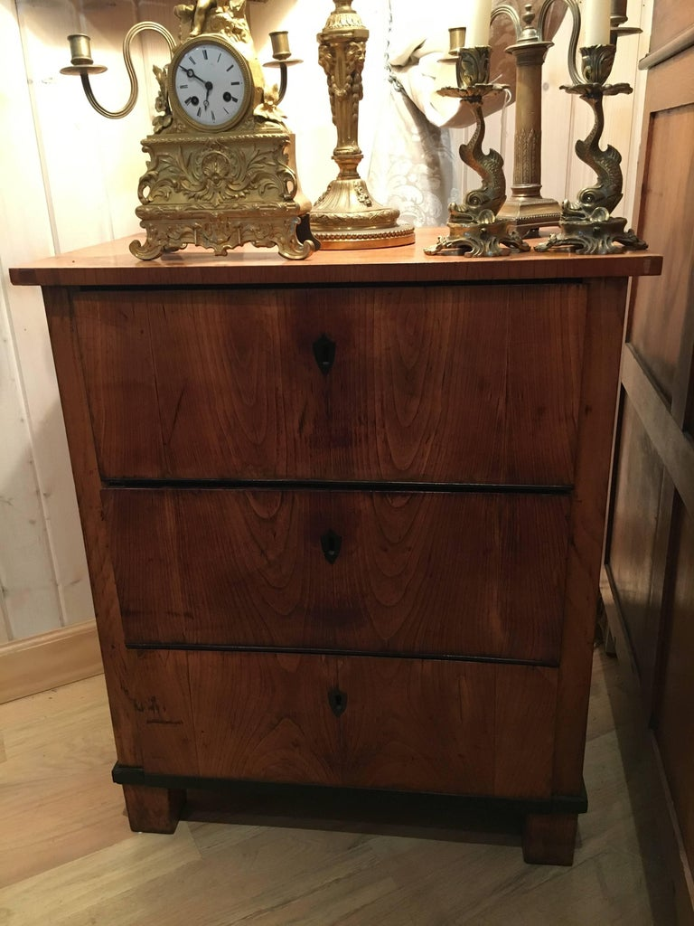 An Italian fruitwood neoclassical three-drawer chest. Measure: Height 30 1/2 x width 25 1/2 x depth 15 1/2 inches.