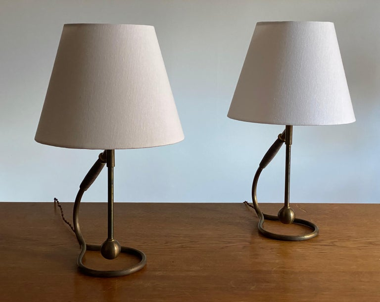 A pair of organic and adjustable table lamps. Designed and produced in Italy, 1940s. In a highly intricate and sculptural form.  Lampshades are attached for illustration and are not included in the purchase. Dimensions stated are excluding