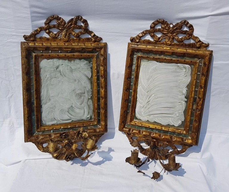 Four mirrors in carved and gilded wood. Appliques in sheet metal and original glass. Rome, late 18th century.