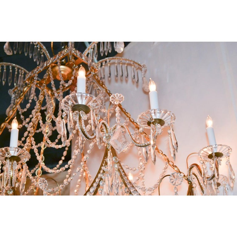 Carved Italian Gilt Brass and Crystal Elongated Chandelier For Sale