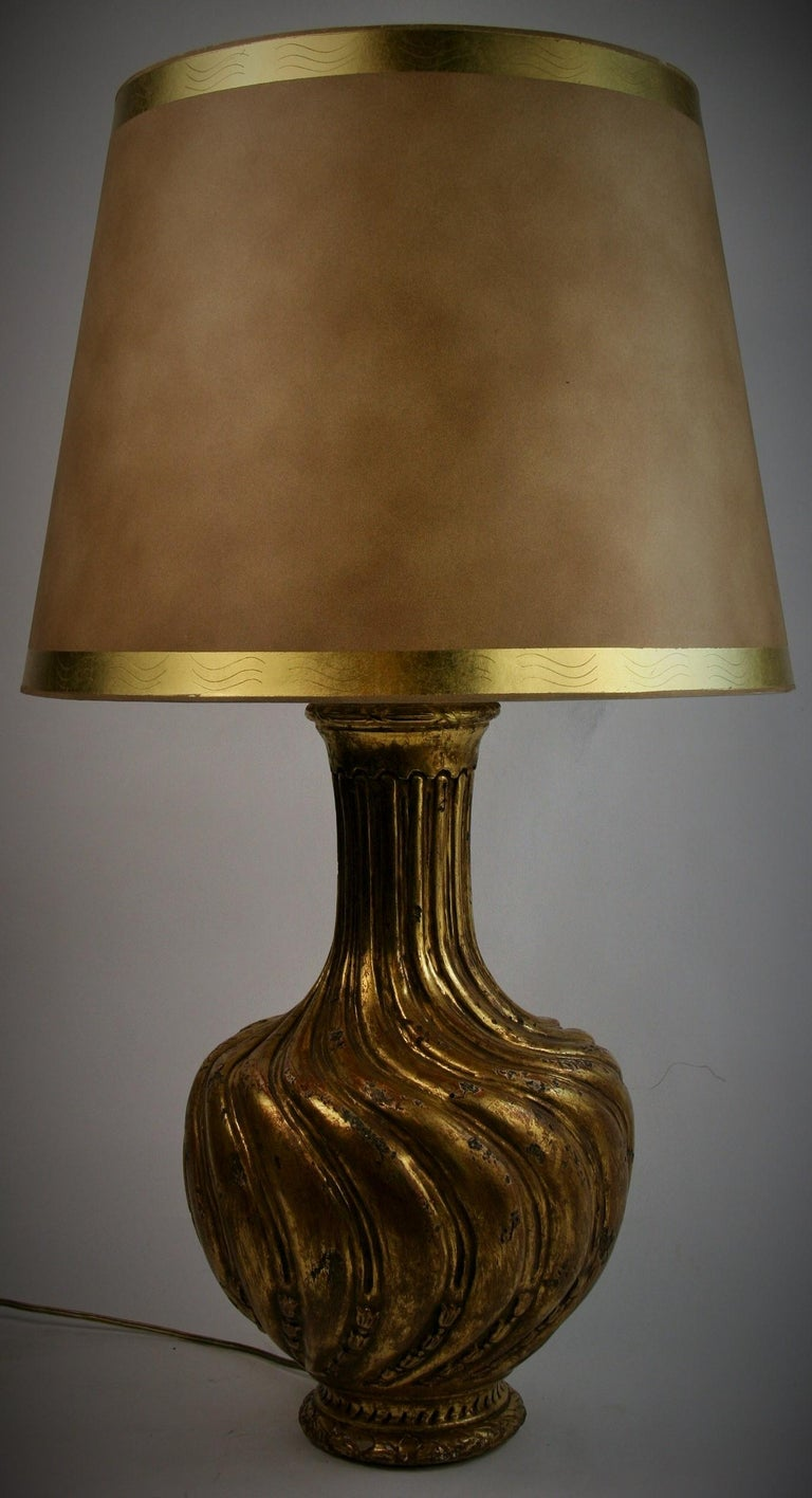 2-296 Italian carved wood and gesso gilt table lamp Has double sockets 60 watt Edison bulb max wattage each. Original wiring in working condition Shade not included 27
