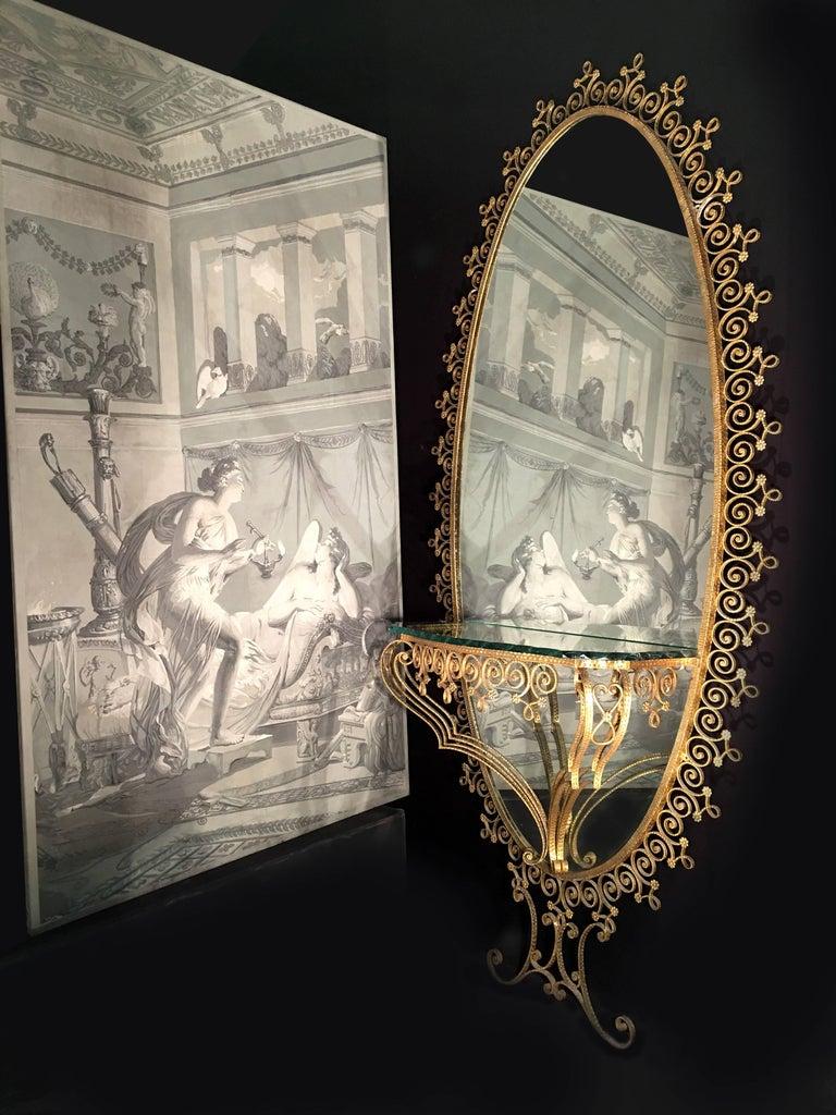 Italian gilt-metal console table and mirror by Pier Luigi Colli, circa 1950s-1960s, a monumental mirror having a