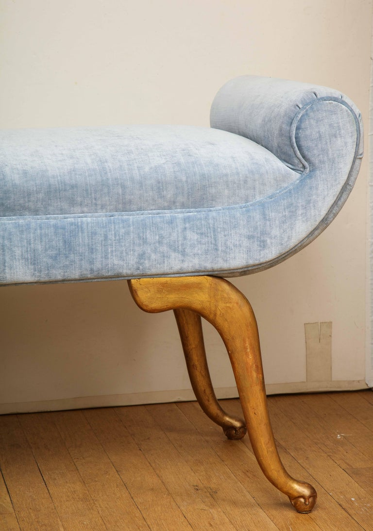 Add a touch of glamour to a room with this chic Italian bench. The giltwood cabriole legs support a scrolled seat in a lush blue velvet. Perfect in a living room, bedroom or ladies dressing room.