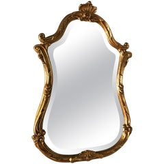 Italian Giltwood Mirror Topped with a Small Shell by Decorative Arts