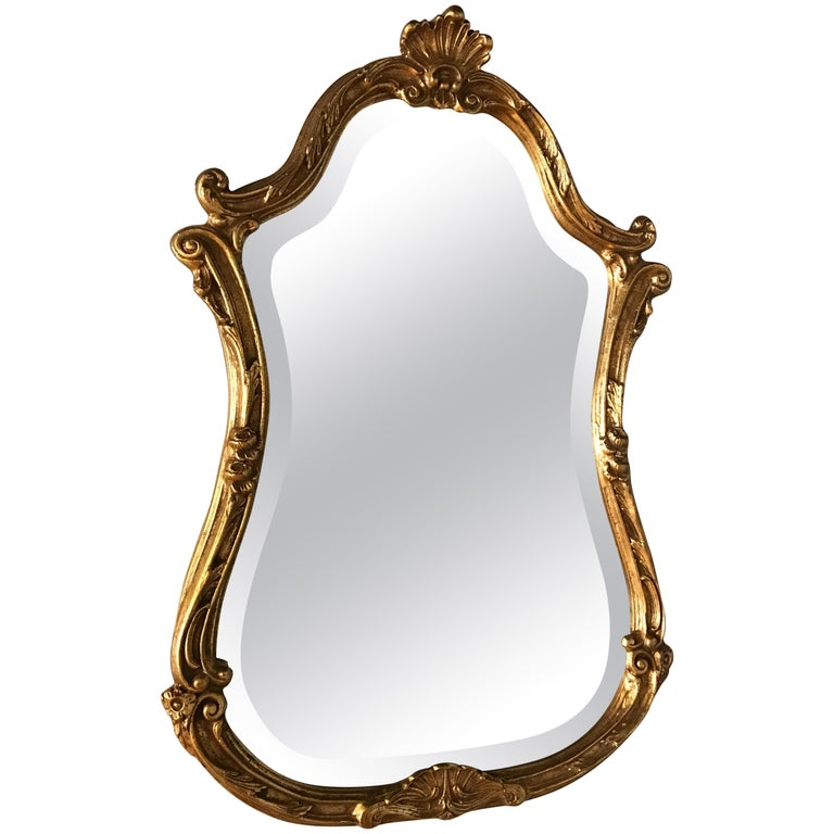Italian Giltwood Mirror Topped with a Small Shell by Decorative Arts For Sale