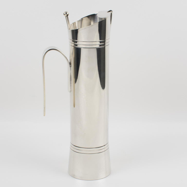 A streamlined and minimalist barware accessory designed by Italian silver master Giuliano Bossi for Ibis, Milano. Sleek and modernist design with extra tall silver plate Martini pitcher or mixer jug compliment with an extra-long stir