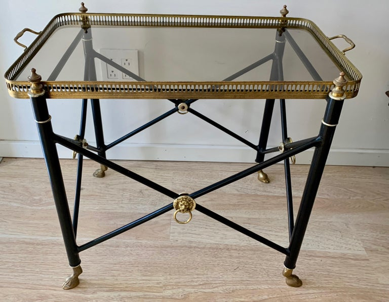 French tray table with smoked glass tray and lion detailing, with brass hoof feet - a wonderful table with removable tray - a handsome cocktail, side or serving / TV table.  Very functional and stylish for any room, from bedroom to fine living