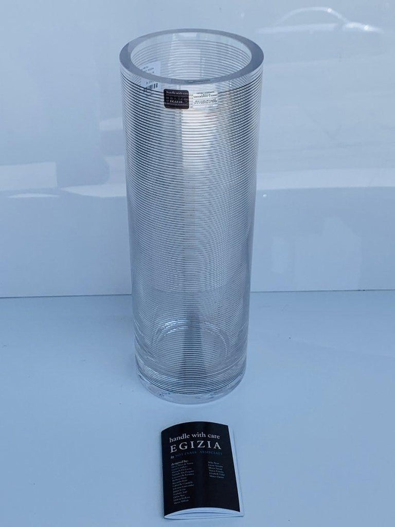 Beautiful glass vase designed by Dafne Koz, manufactured by Sottsass Associati for Egizia.  Made in 1998.  The vase decoration is done in hand silkscreen printing with 980/1000 silver, Baked at 540°.  New in the box.  Measures:  14 inches