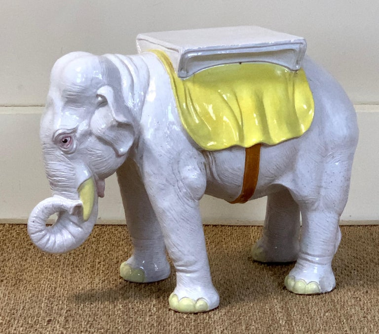 A very charming and beautifully rendered mid-20th century. Italian paint decorated glazed ceramic elephant garden seat.