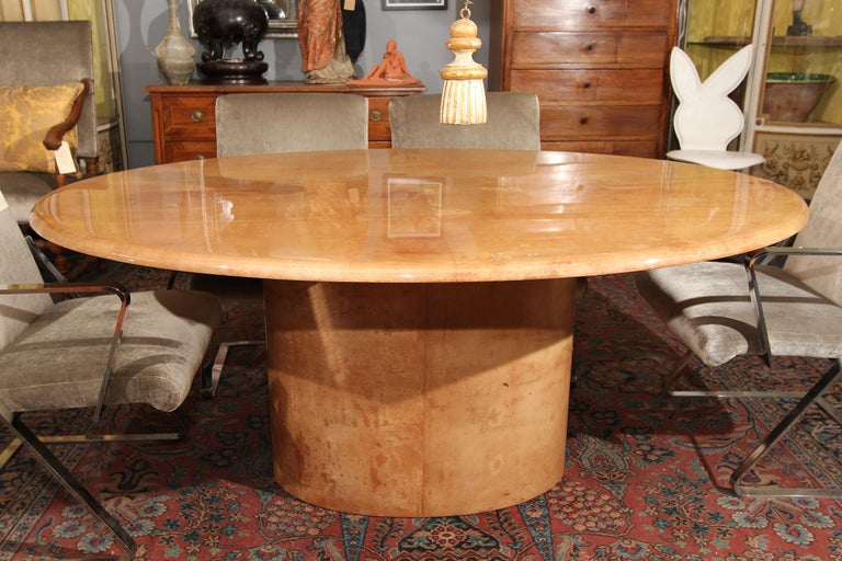 Italian lacquered goatskin oval dining table with oval pedestal base. Beautiful color and condition. Perfect desk or entry table.