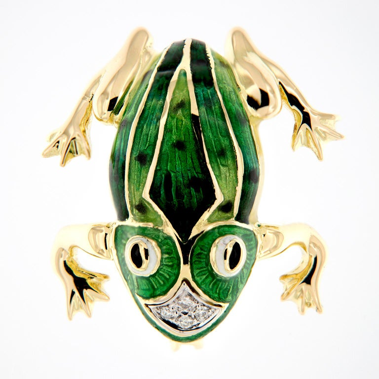 A lovely enameled frog pin, made in Italy and crafted in 18k yellow gold. This piece features rich, green enamel work and accented with four diamonds. Can be also worn as a pendant. Weighs 12 grams.  Diamonds 0.04 cttw