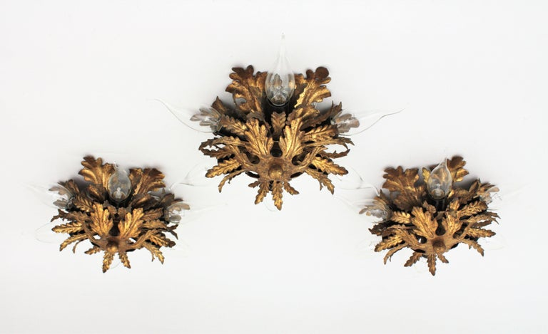 A set of three hand-hammered metal leafed sunburst flush mount lights / wall sconces, Italy, 1950-1960s.