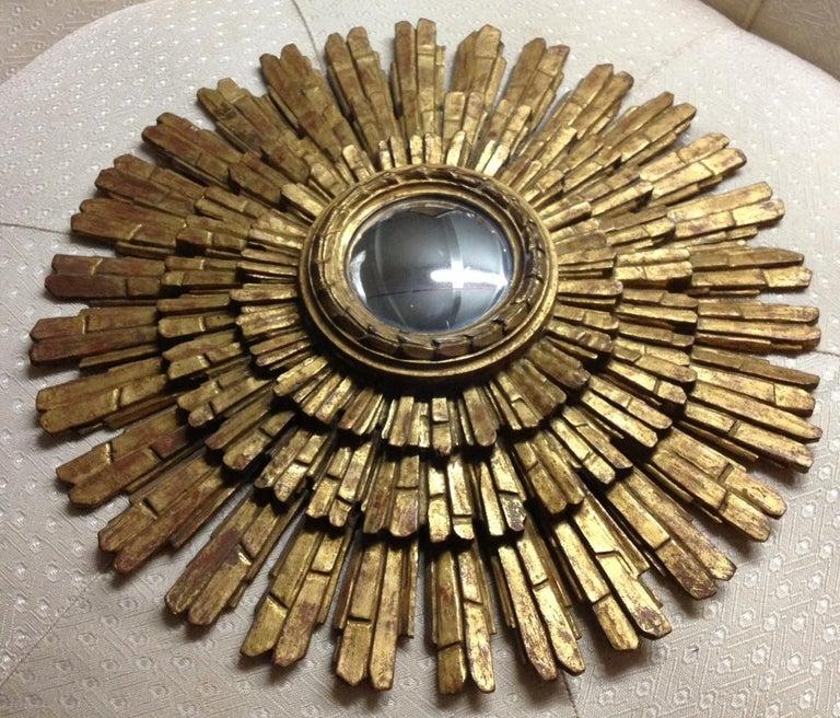 Hollywood Regency style triple hand carved framed giltwood Italian sunburst wall mirror. Mirror is convexed.