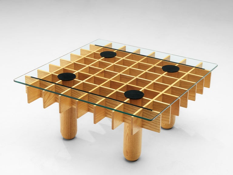 Coffee table, in maple and glass, Italy, 1974.  This blond coffee table from Italy consists of a wooden grid, build up out of maple laths. Four solid round legs. On the grid rests a squire glass top. Black leather felts protect the glass and