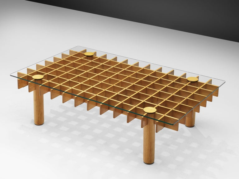 Coffee table, in maple and glass, Italy, 1970s.  This blond maple coffee table from Italy consists of a wooden grid, build up out of maple laths. Four solid round legs end up in four round ends. On top of the grid rests a rectangular glass