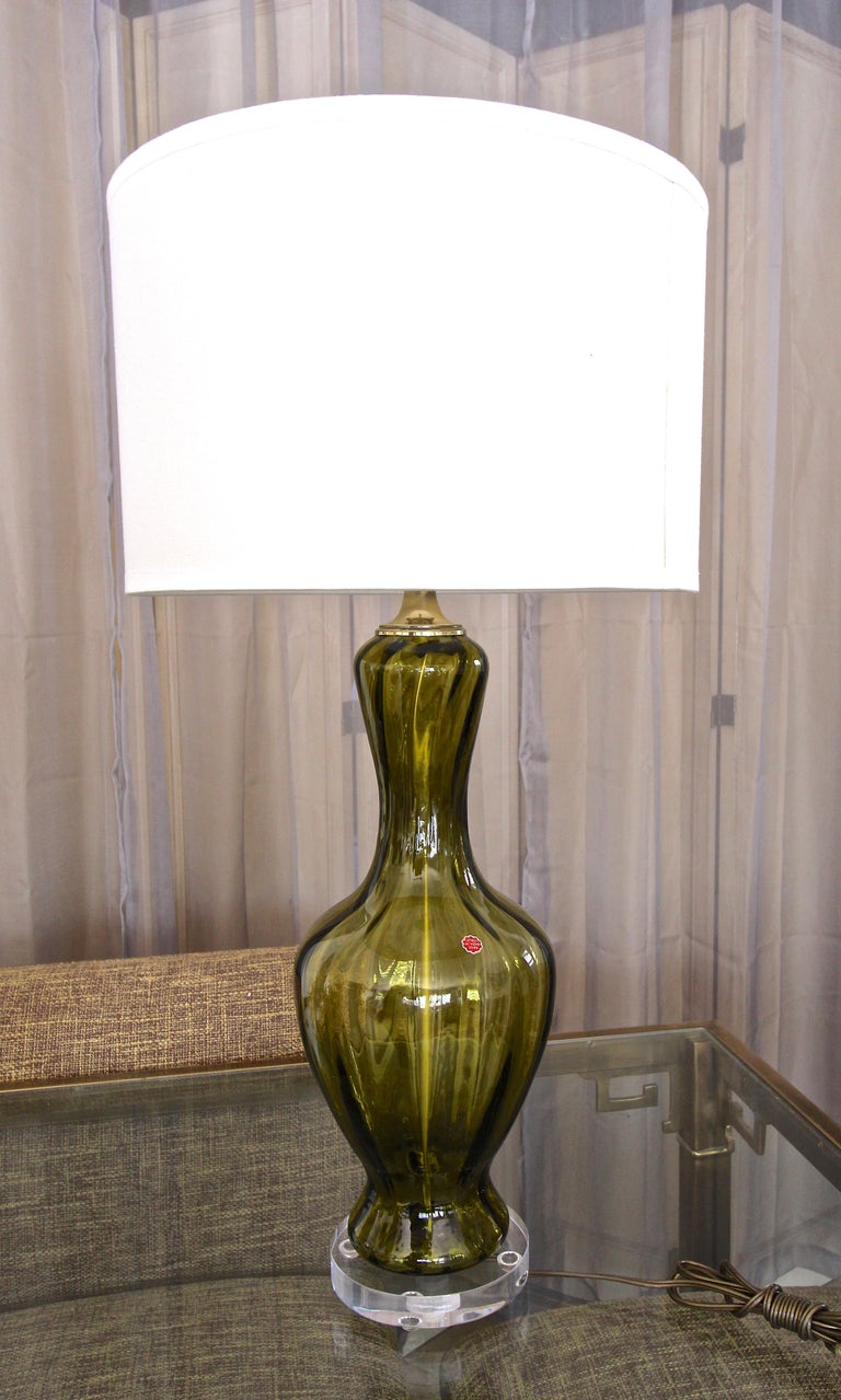Murano hand blown glass absinthe green colored table lamp, on custom acrylic base with brass fittings. Newly wired with new 3-way brass socket and cord. Overall height glass top of socket 24
