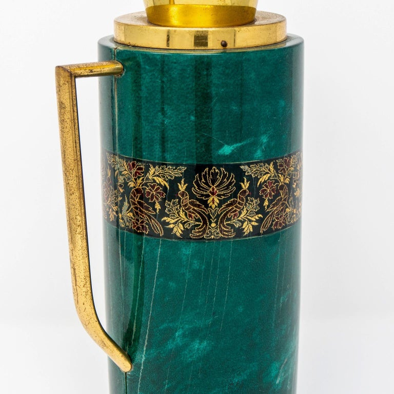 Barware decanter designed by Aldo Tura for Macabo features a leather-wrapped vessel with a malachite colored finish with brass handle and spout, circa 1950s. Cork stopper.