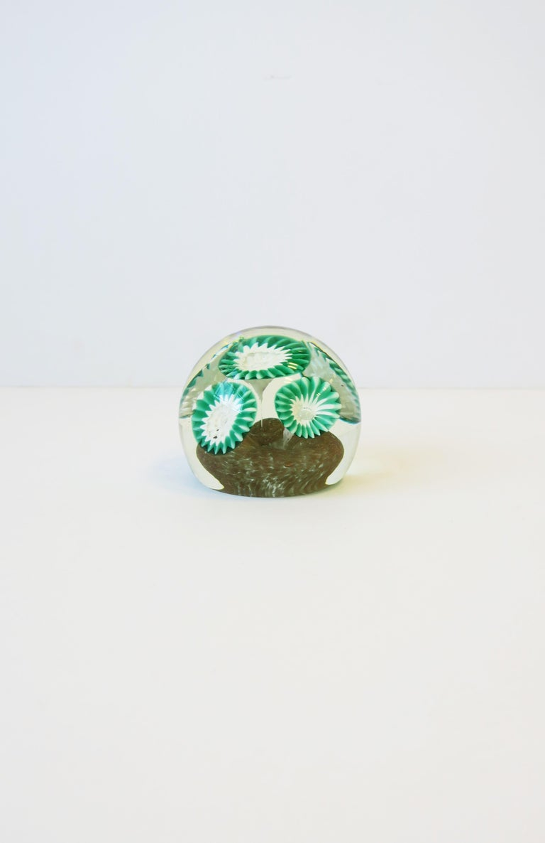 A very beautiful Italian green, white, shimmering copper and clear art glass decorative object or paperweight with a 'flower' design, circa 20th century, Italy.   Measures: 2.75