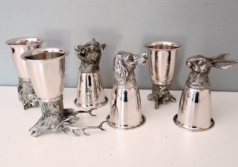 Beautiful set with 6 different drinking cups from the hunting environment, made of silver-plated metal. All cups are signed with