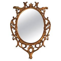 Italian Hand Carved Gilded Oval Rococo Mirror