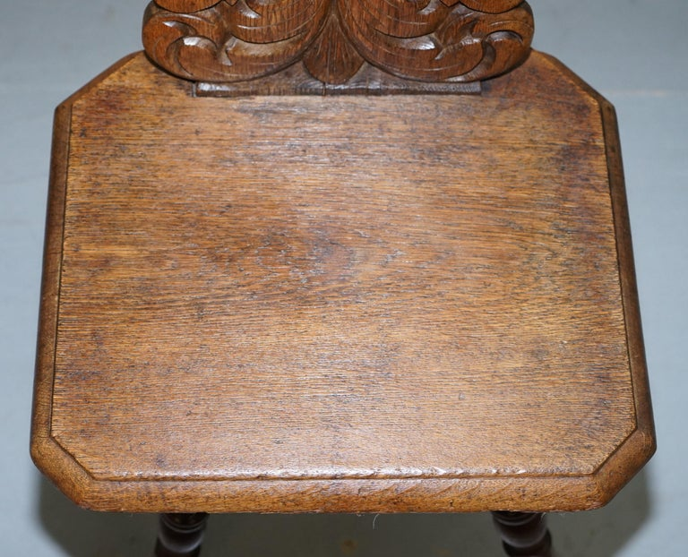 Hand-Carved Italian Hand Carved Oak Hall Chair with Ornate Wood Floral Cresting Back Rest For Sale
