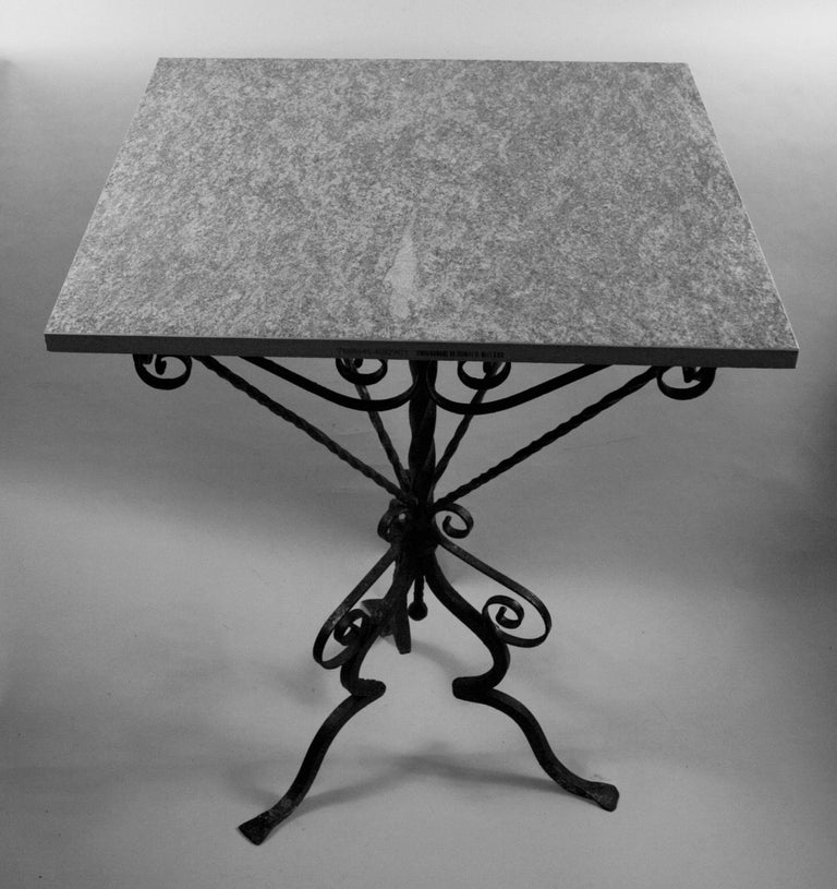 3-625 Italian hand made scrolled iron base with new ceramic top.