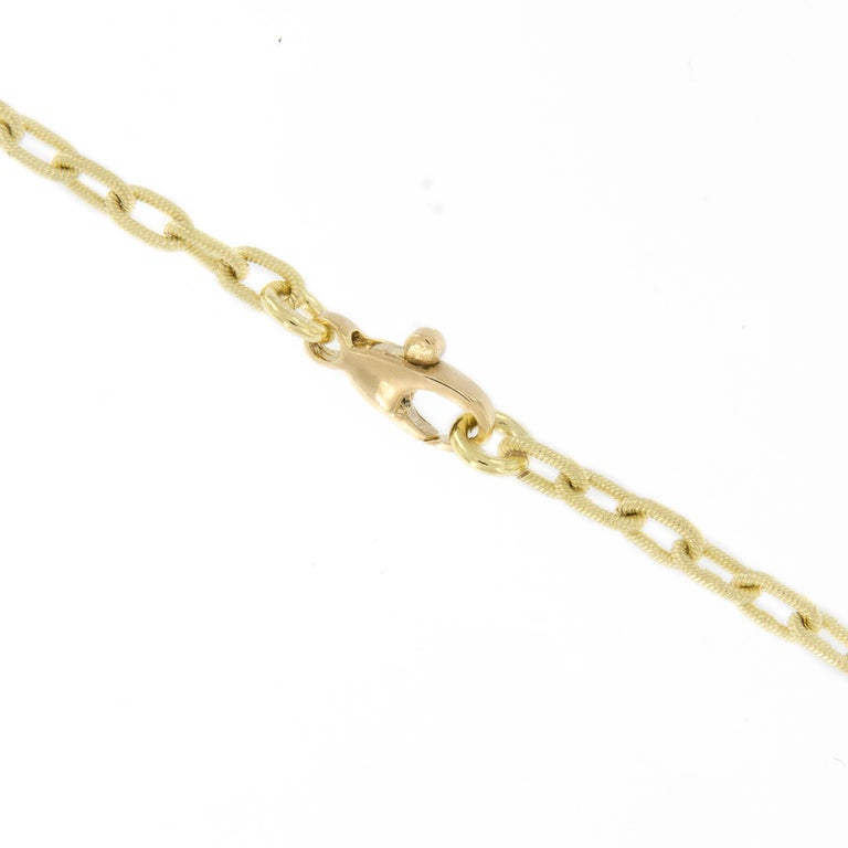 Beautiful handcrafted Italian 18k gold ribbed oval link chain necklace with a lobster clasp. The 18 inch long necklace shimmers on the skin from the soft color & craftsmanship executed on the ribbed finish.  18KYG 18