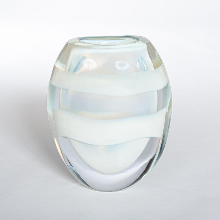 Modern Italian opalescent colored Murano glass vase signed by Pino Signoretto. A transparent glass object made out of thick glass layers (total 2.5cm) shaped like eggs made in Sommerso Technique with two white circular color stripes. Hot glass