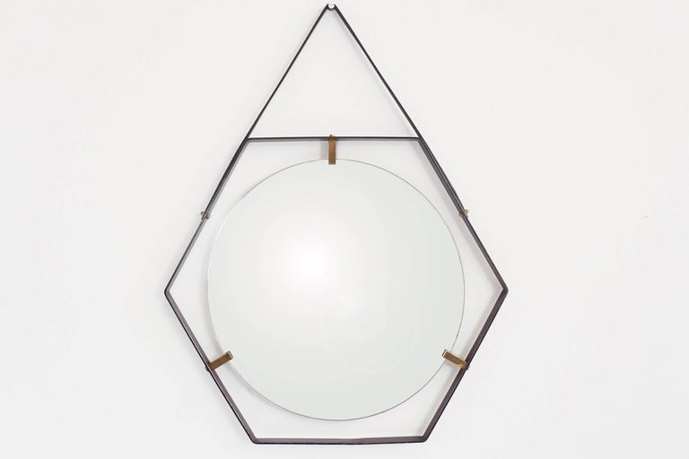 Stunning wall mirror by the producer of Sottsass works.