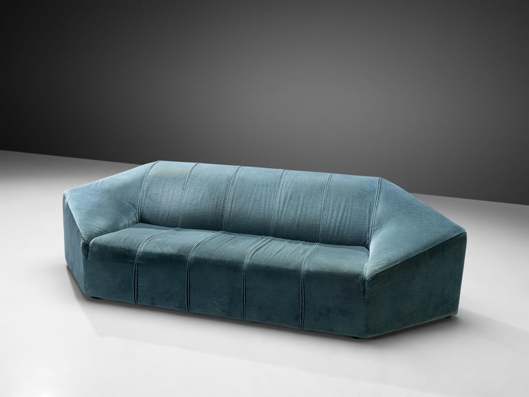 Three-seat sofa, acquamarine velour upholstery, Italy, 1960s  Extravagant sofa in spectacular hexagonal shape. The Italian sofa has a solid base of which the backrest rises diagonally. This results in large and wide armrests and a thick backrest.