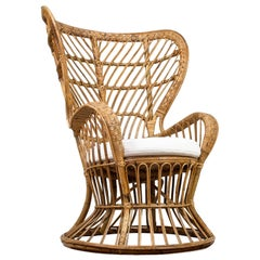 Italian High Wingback Rattan Armchair with White Felt Cushion by Lio Carminati