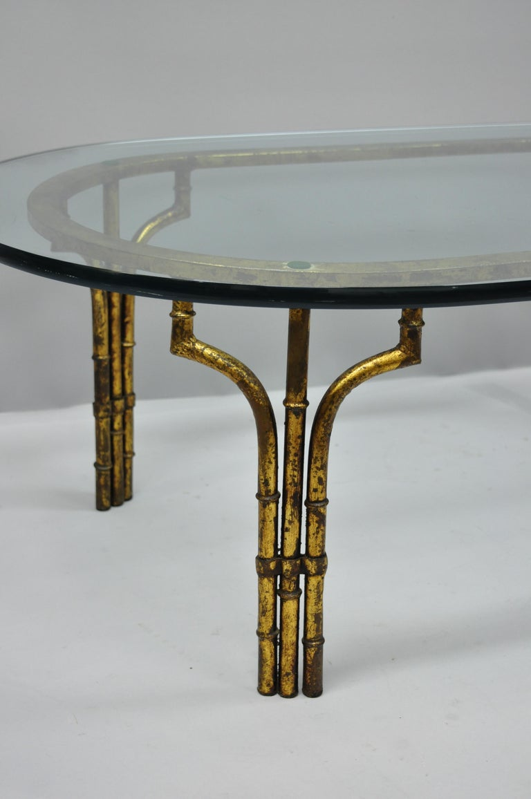 Vintage Italian Hollywood Regency faux bamboo gold gilt metal coffee table. Item features .75