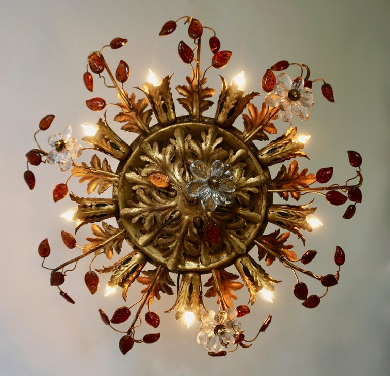Beautiful flush mount fixture which can be used also as wall sconce - this Italian gilt metal light with gilt metals leaves, small orange glass leaves and transparent flowers is gorgeous! The light fixture has 9-light bulb holders spread around as a